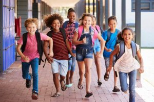 Kids Running In Schoolyard Jpg